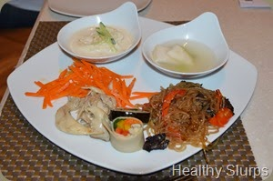 Clockwise - Cold Noodles, water kimchi, japchae, Gimbap, and some salad