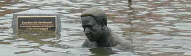 An Annapolis statue commemorating 'Roots' author Alex Haley is inundated during Hurricane Isabel in 2003. Photo: UCS
