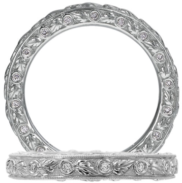 For an Old World style, this Ritani Romantique eternity band features bezel-set diamonds and hand-carved leaves.