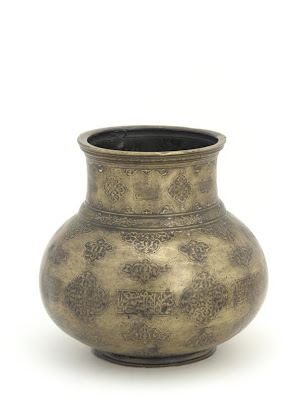 Jug (mashrabah) | Origin:  Iran | Period: early 16th century  Safavid period | Details:  Not Available | Type: Brass, traces of gold and silver inlay | Size: H: 12.8  W: 13.3  cm | Museum Code: F1977.4 | Photograph and description taken from Freer and the Sackler (Smithsonian) Museums.