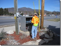 NC DOT workers adjust the signal!