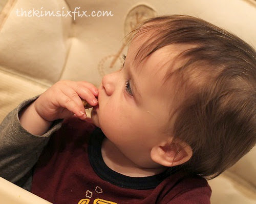 Baby eats brussel sprouts