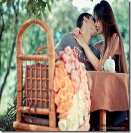 Kissing-couple-on-table-hug-love-teen-age-cute-young