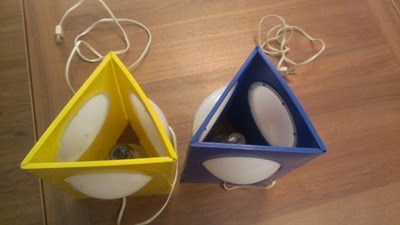 Plastic triangle lamps in yellow and blue top
