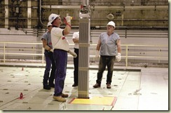 Employees inspect the new fuel assembly that will be used during refueling at Comanche Peak nuclear plant.