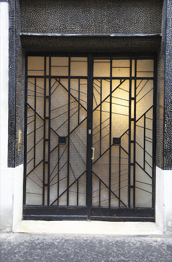 The ultimate in chic: show-stopping glass and iron doors capture both the tradition and whimsy of Paris.