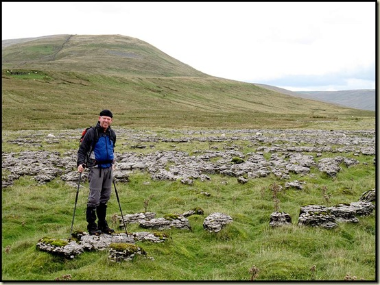 Mick on the Scales Moor limestone pavement, with Whernside behind