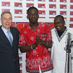 Prof Casey and Prof Mutere pose with a presenter at Hitz FM.JPG
