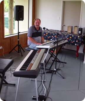 Our host, Dave Winslade, sound checking his Yamaha Tyros 4 during set-up at the Community Hall.