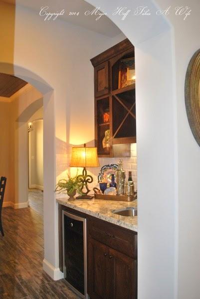 Dark wood butlers pantry with built in wine fridge