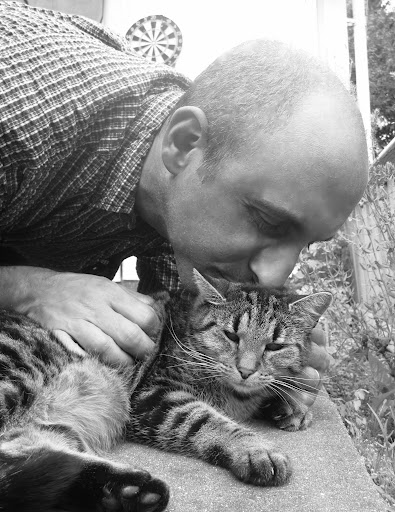 Real men kiss kitties!