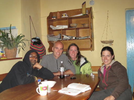 Enjoying a little aguardiente with Nirmal and Michele in the hostel's kitchen, Villa de Leyva, Colombia