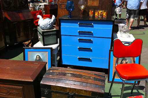 What a great color for the dresser! Only at a flea market can you find a piece like that.