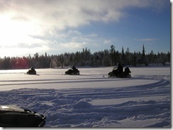 snowmobiles-on-lake