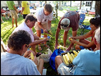 04e - Lobster Boil - shucking corn a team effort