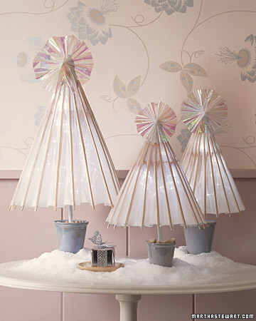 These child-size paper parasols turn a side table into a winter wonderland. Plant them in miniature flowerpots filled with gravel. Tape the umbrellas open just a bit, then tuck in a cluster of batter-powered LED lights.