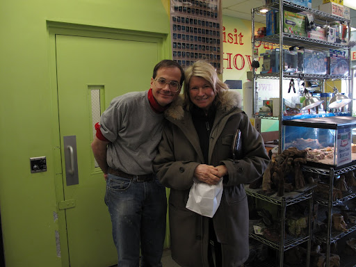 Marc and Martha are old friends and posed for a photo.   Martha is carrying a special sandwich that she bought at a little place called, Happy Hostess, next door to the pet store.