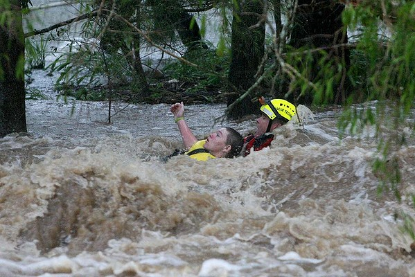 A Swift Water Rescue officer saves a young boy from floodwaters in Rockhampton, Australia, 28 January 2013. Photo: Allan Reinikka / Sydney Morning Herald