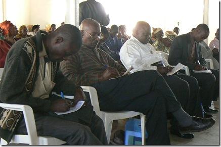 Delegates, taking notes