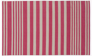 A rug with bright stripes can enliven a space. (madelinewinerib.com)