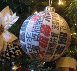 decoupaged Asian newspaper Christmas ornament