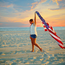I Raise The Flag by Sharon Fuscellaro Canale - People Fine Art ( girl, flag, american, sunset, beach )