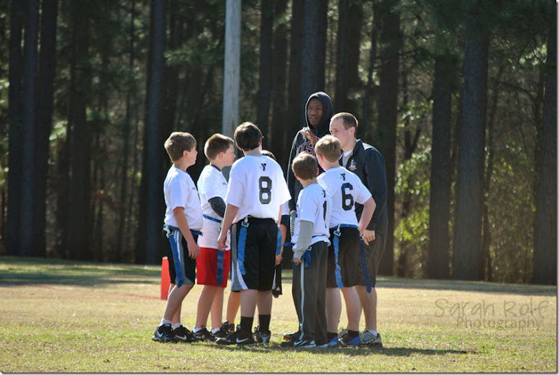 boys in football huddle