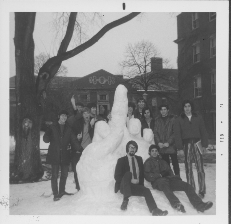 Student Gay Liberation Front members give the finger in snow. February 1971.