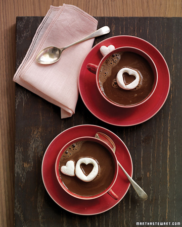 Adorable cut-out marshmallow hearts floating on rich hot chocolate. (marthastewart.com)