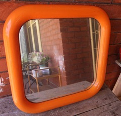 Orange framed mirror, front