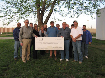 Front Row: Ron and Angie Stover, youth center donors; Joyce Taeger, Monsanto seed corn dealer; Bryan Townsley, Louisa County Fair Board President; Dean Taegler, Monsanto seed corn dealer; and Lee Fraise, Monsanto. Back Row: Tony Humiston, Louisa County Fair Board Vice President; Royce Bonnichsen, Bob Schlutz, Rich Beard and Mark Huston, Louisa County Fair Board members; Susan Pretz, Louisa County Fair Secretary/Treasurer and Tim Whittaker, Louisa County Fair Board member.  Photo courtesy:  Louisa County Fair Board