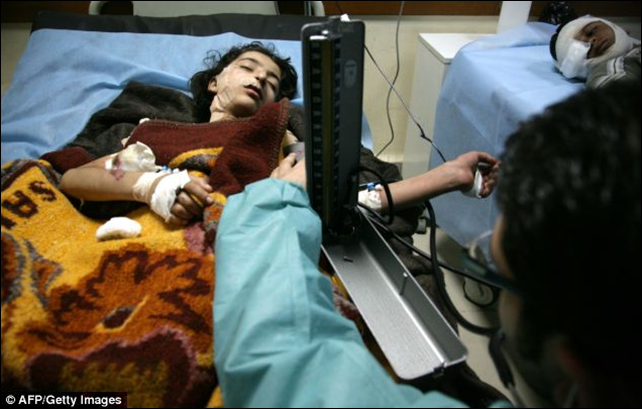 Wounded Iraqi children are treated at a hospital in the northern Iraqi city of Dohuk. Bombers detonated explosives-rigged vehicles at a police station and a primary school in October 2013. Photo: AFP / Getty Images