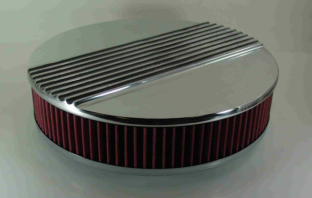 """14 3/8"""" round aluminum with cotton gaze filter. 4 1/4"""" tall. Fits all carbs with a 5 1/8"""" neck. 185.00"""