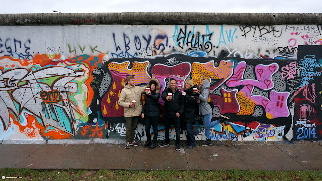 family pose at the Eastside Gallery in Berlin in Berlin, Berlin, Germany