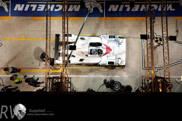 The LMP2 class winning Starworks HPD in the pits at night (PHOTO:  MacLean Photographic)