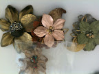 Colette Malouf had some leather flower clips that I thought would be perfect for a fall wedding. Wouldn't they look pretty in your bridesmaids' hair?