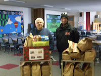 KCII's General Manager delivering food at the Asbury United Methodist Church in Wellman