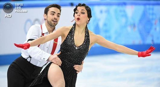 Feb 16, 2014; Sochi, RUSSIA;  Sara Hurtado and Adria Diaz of Spain perform in the ice dance short dance program during the Sochi 2014 Olympic Winter Games at Iceberg Skating Palace.  Mandatory Credit: Robert Deutsch-USA TODAY Sports
