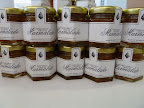 Annie's sister-in-law, Alison, made bergamot-orange marmalade for one of the favors. It was packaged in hexagonal jars and finished with labels.
