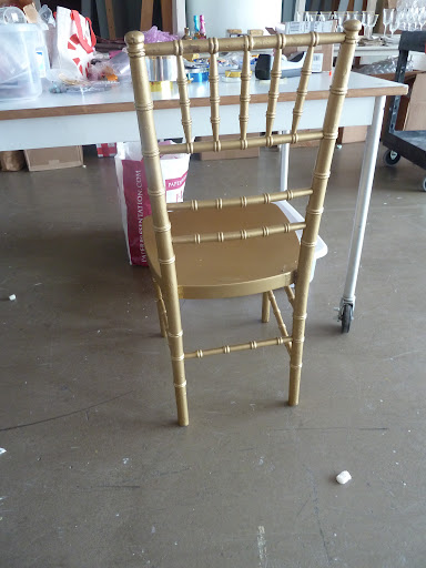 A classic gold reception chair from Party Rental Ltd.