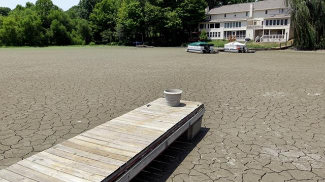 2012 record weather: A dock extends into a dry cove at Morse Reservoir in Noblesville, Indiana, as oppressive heat and drought conditions stifle the middle of the U.S. Michael Conroy / AP Photo