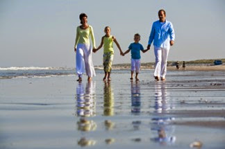 happy family walking along the beach