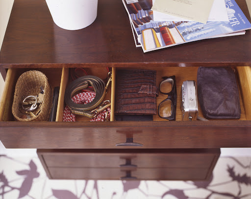 The drawers are the perfect size to store keys, dog leashes and other items. The top of the drawers double as a place to drop mail.