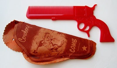 red gun comb with paper sleeve holster