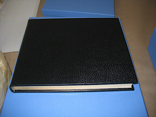 Here's a black album from Smythson. Note the elegantly gilded edges on the pages.