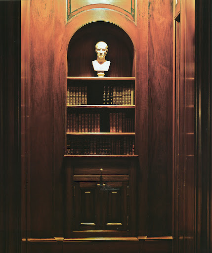 Weatherstone's library is a dark, masculine space.