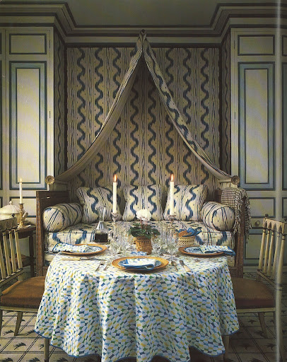 The walls and sofa are covered in the sexy serpentine-like Toile de Vence, offset by a Colefax and Fowler carpet called Double Check Flash.