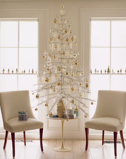The sparse branches of a 1960s aluminum tree provide plenty of room to show off ornaments. The tree is anchored in a sand-filled vase, which replaces its base.