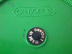 green and black Crayonne ashtray, imprint and sticker