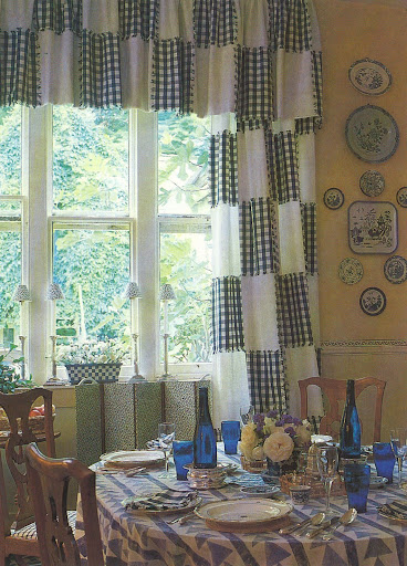 Blue and white check dusters sewn into simple white cotton curtains. That's a Good Thing.